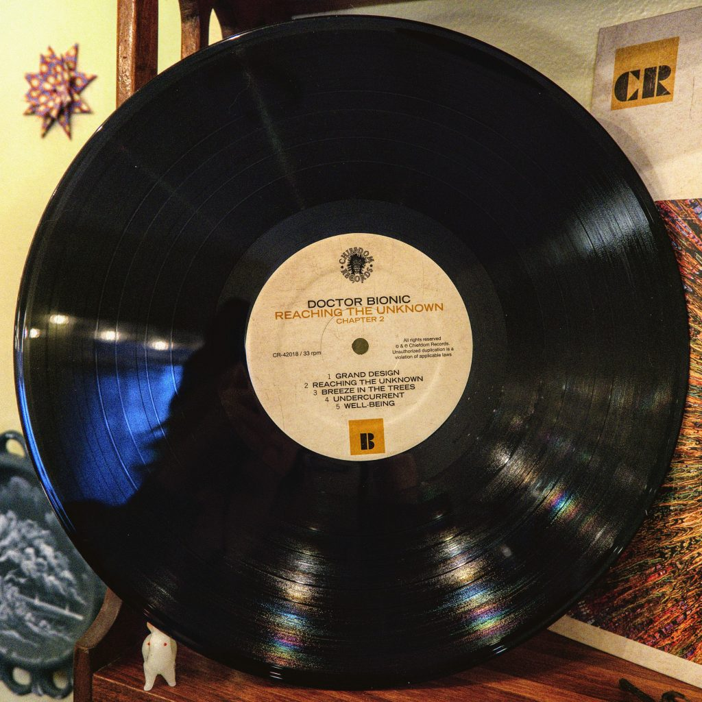 An image of a vinyl record by Doctor Bionic called Reaching The Unknown.